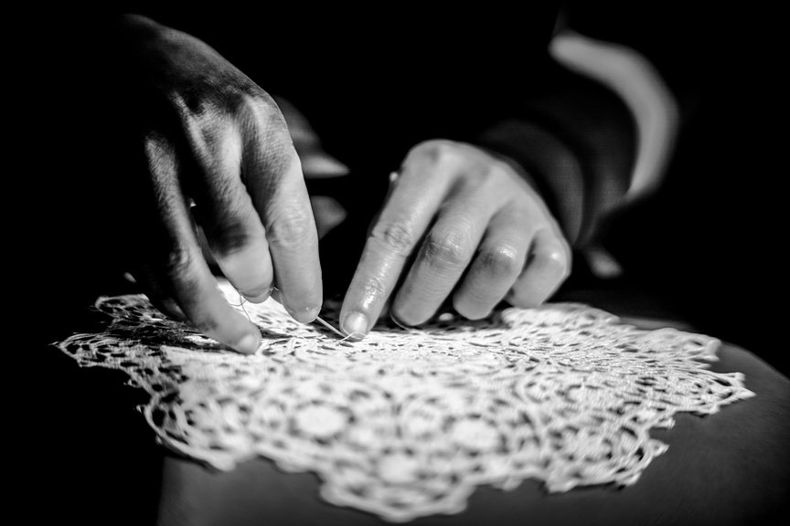 Hands making Pag lace